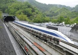 The Maglev (magnetic levitation) train speeds during a test run on the experimental track in Tsuru