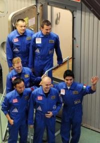 The Mars 500 volunteer crew members smile for the press before being locked into the isolation facility