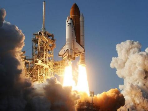 The space shuttle Discovery lifting off from Kennedy Space Center in Florida in February
