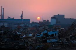 The sun sets over debris