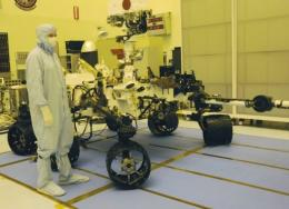 The US space agency has postponed by one day its plan to launch the biggest rover ever to Mars