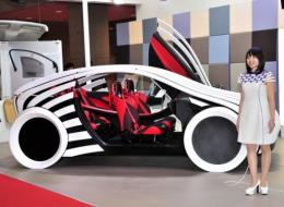 Toyota affiliate Toyota Boshoku displays a study model of a 'T-Brain' four seater car at the Tokyo Motor Show today