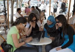 Tunisian girls check their computers in a Wi-Fi cafe on the Habib Bourguiba Avenue in Tunis in 2010