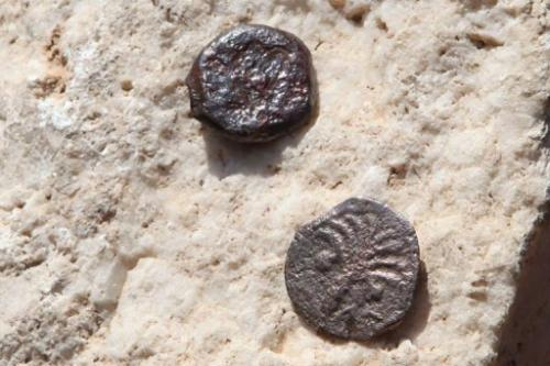 Two ancient bronze coins recently revealed in excavations
