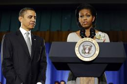 US First Lady Michelle Obama speaks before President Barack Obama