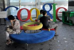 Visitors sit on a bench at a lobby of an office of Google Korea in Seoul