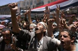 Yemeni anti-government protesters attend a demonstration in Sanaa
