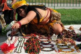 A Brazilian Indian prepares her souvenirs stand before the inauguration of the People's Summit