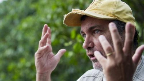 Brazilian biologist Mario Moscateli talks about pollution in the Marapendi lagoon on December 12, 2012
