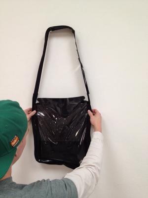Industrial design students create solar bag that purifies water while person walks