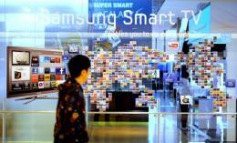 A South Korean man walks past a Samsung Smart TV advertisement