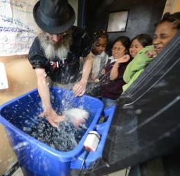 Christopher Toole teaches children about aquaponics