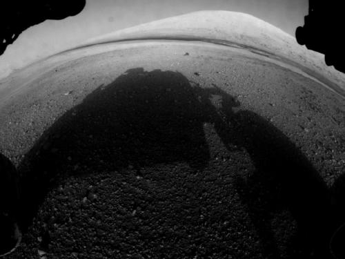 Mars rover Curiosity beams back images showing its descent