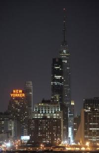 File photo shows New York's Empire State Building turn off its tower lights in March 2010