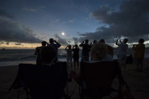 Clouds part, solar eclipse darkens north Australia