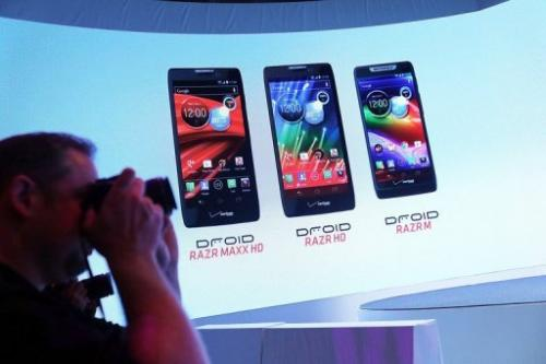 Members of the media attend the launch of three new Motorola smartphones under its Razr brand