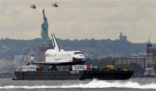 Space shuttle Enterprise floats to Manhattan home
