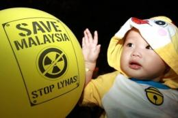 A child is seen during a protest against Lynas Corporation in Kuantan