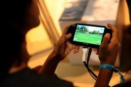 A child plays a handheld video game