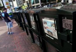 A copy of USA Today is displayed in a newspaper vending rack in 2009