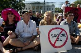 Actress Daryl Hannah sits in front of the White House in August during a protest against the Keystone XL pipeline
