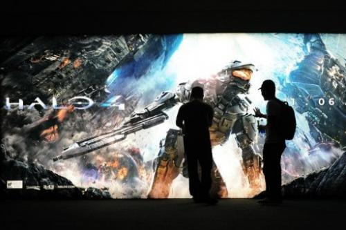 A gaming fan touches the advertising for Halo 4 at the Nintendo section on the E3 videogame conference in June 2012