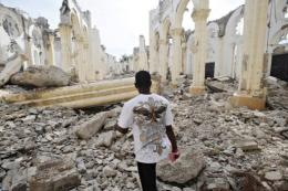 A Hatian man walks through the ruins of the Cathedral in Port-au-Prince in 2011