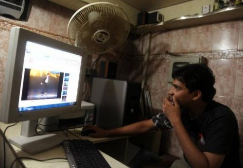 A Karachi resident is seen browsing video sharing website YouTube at an internet cafe, on May 27, 2010