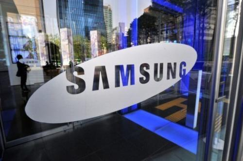 A logo of Samsung Electronics on the glass door of its showroom in Seoul on April 27, 2012