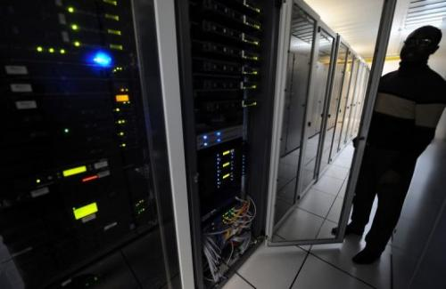 A man checks servers in a data center