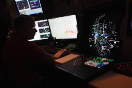 An air traffic controller monitors flights