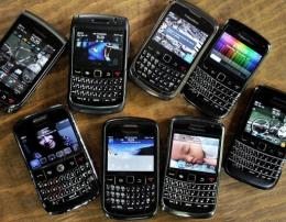 An assortment of Blackberry smartphomes seen at a restaurant in Jakarta