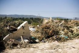 An illegal waste-dump is found near Asopos river, in Greece