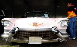 A pink Cadillac like that seized from Kim Dotcom, along with a Rolls Royce Phantom