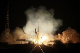 A Russian Soyuz-U booster blasts off a launch pad at the Russian leased Kazakhstan's Baikonur cosmodrome