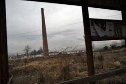 A smoke stack stands in an abandoned industrial plant in the town of Lom in Bulgaria.