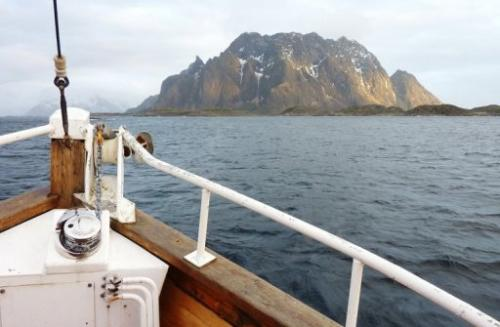 A tourist vessel plies the waters around Norway's Lofoten archipelago