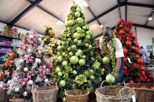 A vendor displays Christmas decorations on a christmas tree in a shop in Johannesburg