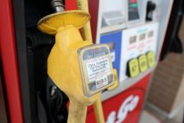 A warning label is posted on an E85 Ethanol pump handle at a gas station