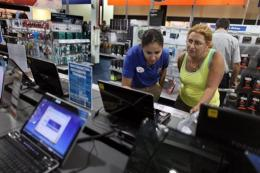 A woman shops for a computer at a Best Buy store in 2009 in Miami, Florida