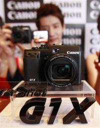 Canon seeks full automation in camera production (AP)