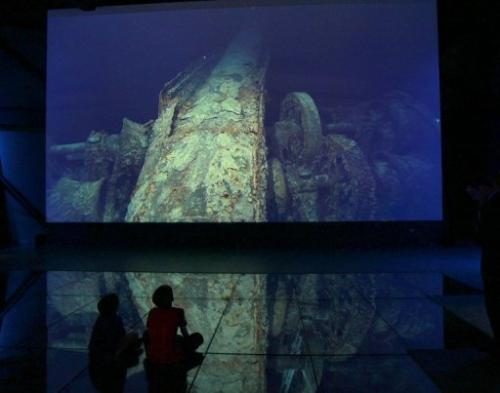 Children look at images of the Titanic wreck on the seabed at the Titanic Belfast visitor centre