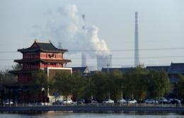 Cooling towers and smokestack chimneys of a coal-fired power plant are seen on the outskirts of Beijing