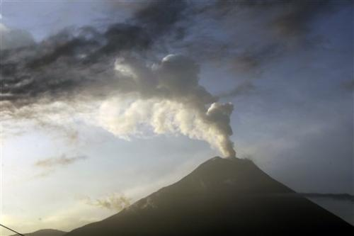 Ecuador volcano blasts more hot rock from crater