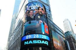 Facebook co-founder Mark Zuckerberg pictured on a screen getting ready to ring the NASDAQ opening bell on May 18