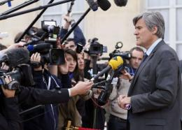 French Agriculture Minister, Stephane Le Foll (R), answers journalists' questions