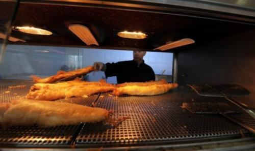 Fried haddock are served at a fish and chip Takeaway in Manchester, northwest England, on March 10, 2010