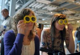 Girls explore a display at the Copernicus Science Centre