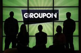 Groupon reports smaller 1Q loss, higher revenue (AP)