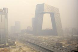 Haze covers the new China Central Television headquarters building in Beijing on March 2